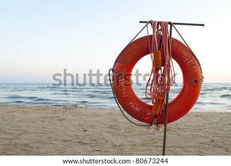old lifebuoy against the sea - stock photo