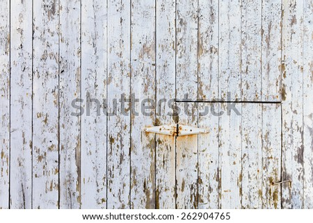 old light-blue wooden wall background texture with rusty hinge - stock photo