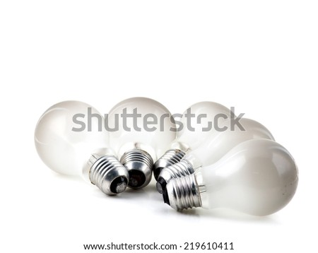 Old light bulb isolated on white - stock photo