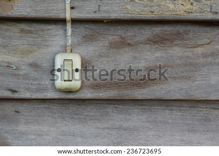 old light switch on wooden wall - stock photo