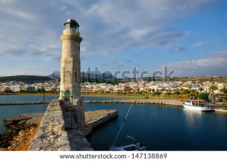 Old lighthouse and view on city of Rethymno, Crete, Greece - stock photo