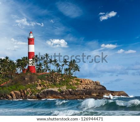 Old lighthouse and waves of  sea. Kovalam (Vizhinjam) Kerala, India - stock photo