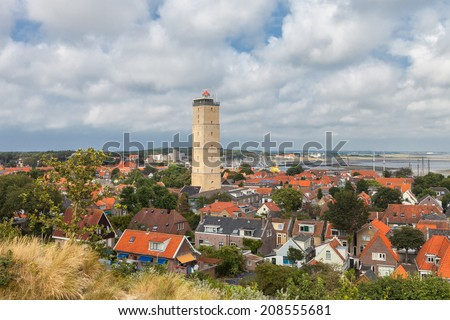 Old lighthouse in a small village on the island Terschelling in the Netherlands - stock photo