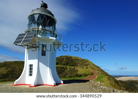 Old lighthouse in Cape Reinga, New Zealand - stock photo