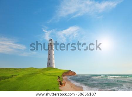 Old lighthouse on sea coast - stock photo