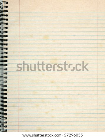 Old lined paper in a notepad. - stock photo