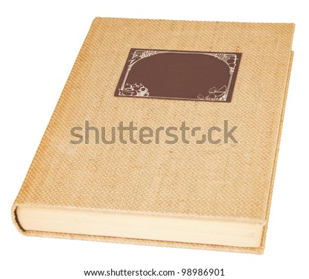 Old linen book with a brown label over a white background - stock photo