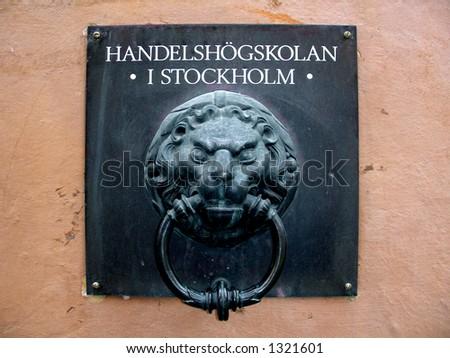 Old lion doorknocker in Stockholm - stock photo