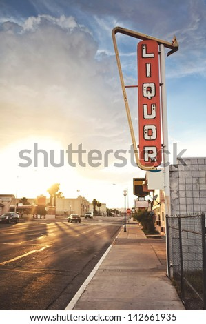Old liquor store sign founded on Route 66, USA - stock photo