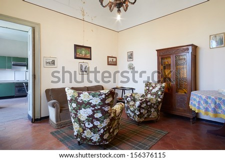 Old living room in country house - stock photo