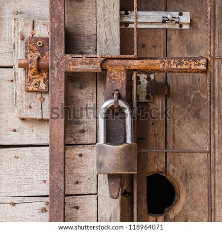 old lock on a door - stock photo