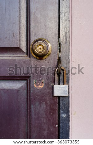 Old lock on the door.close-up. focus on lock. - stock photo
