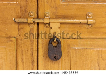 Old Lock On The Old Door in India - stock photo