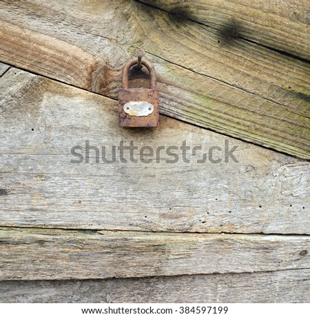 Old lock on vintage wooden wall - stock photo