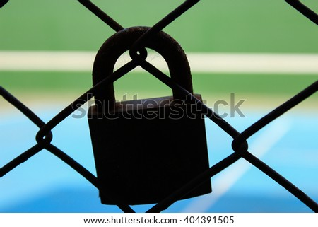 old lock silhouette and green and blue background - stock photo