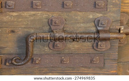 old lock with deadbolt to close the door of the medieval castle - stock photo