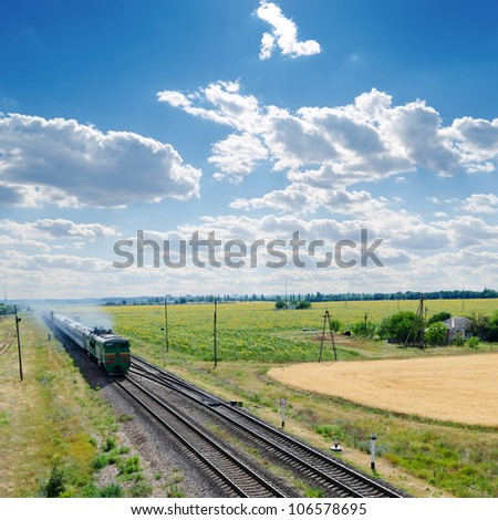 old locomotive with train on railroad - stock photo