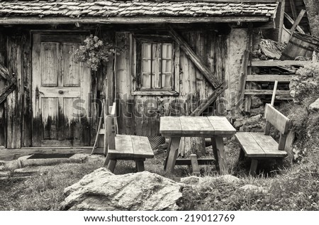 old log cabin at the european alps - stock photo