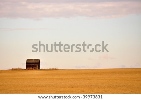old, lonely shack on the open prairie - stock photo