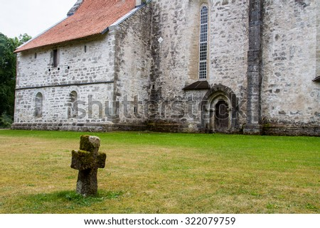 Old lonely stone cross - stock photo