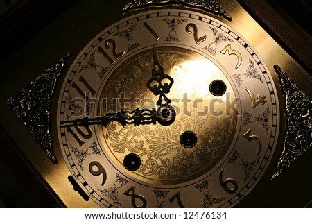 Old looking grandfather clock face - stock photo