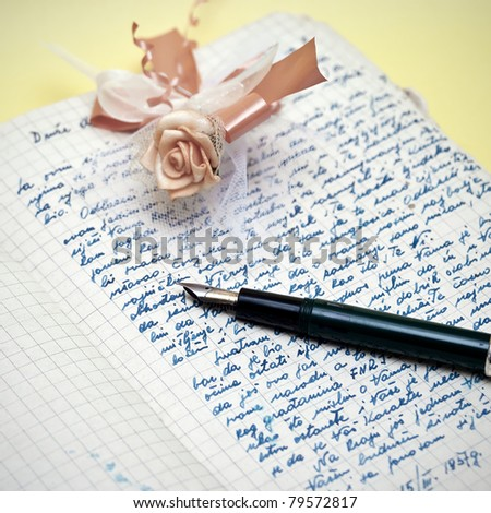 old love letter and pen on the table - stock photo