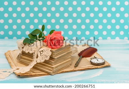 Old love letters and postcards with pink rose flower. Nostalgic sentimental still life. Retro style designed picture - stock photo