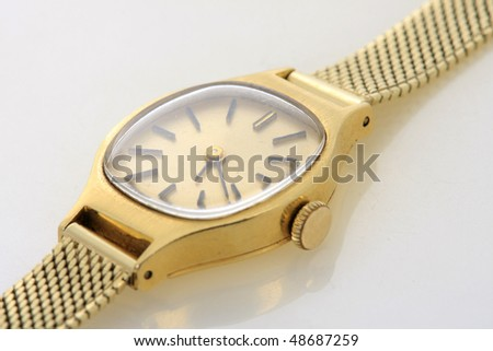 Old, Luxury, Hand-made gold watch on white - stock photo