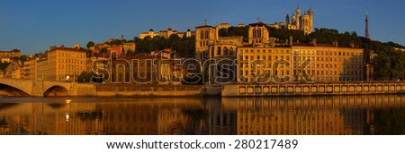 Old Lyon panoramic format cityscape form the river. The beautiful buildings are reflected in the water.  - stock photo