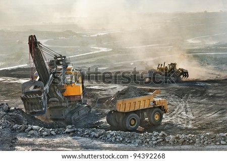 Old machine in coal mine - stock photo