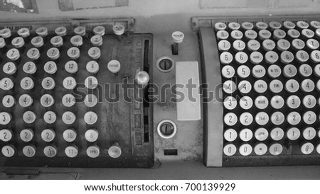 old machine, old tax calculator, black and white style