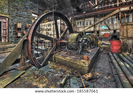 Old machinery in derelict workshop HDR - stock photo