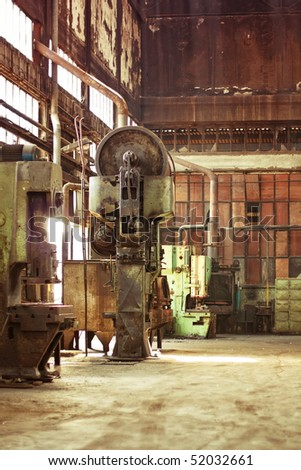 Old machines in abandoned factory - stock photo