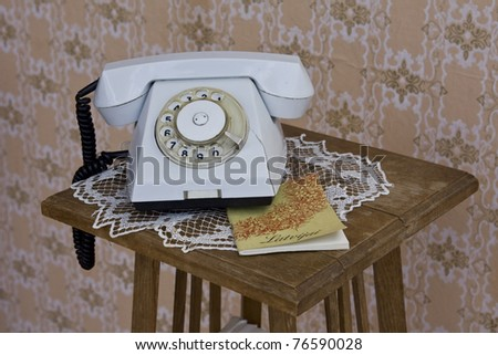 Old made in USSR rotary phone on table - stock photo