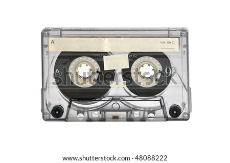 Old magnetic audio tape cassette for music - stock photo