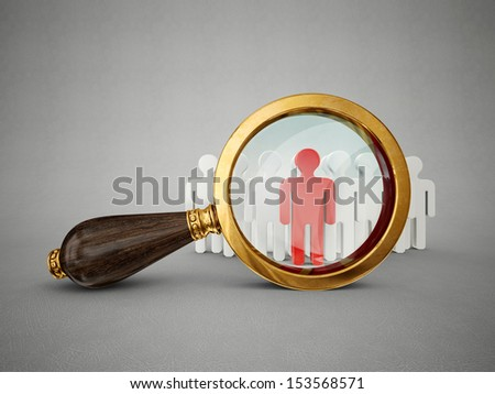 old magnifier and man isolated on a grey  background - stock photo