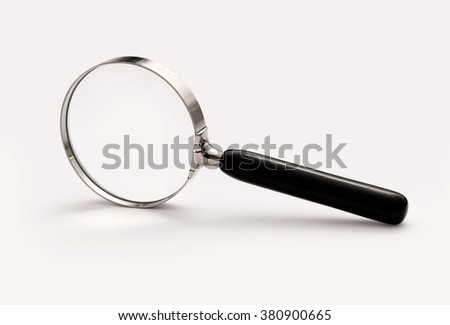 Old magnifying glass/loupe, isolated on a light background and with a clipping path.  - stock photo
