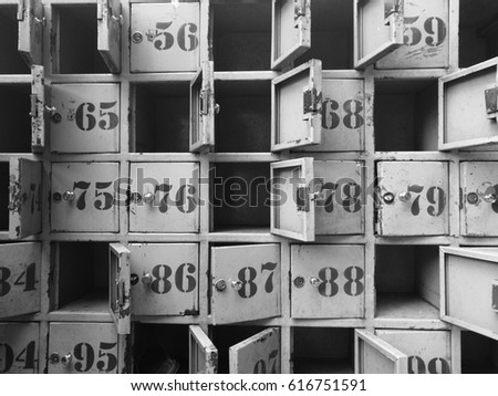 old mail boxes with different numbers, abstract black and white background, telecommunication