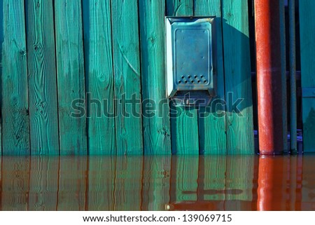 Old mailbox and flood - stock photo