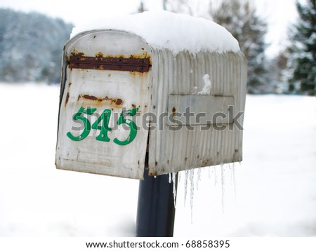 old mailbox in winter - stock photo
