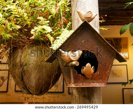 Old mailbox on old wood pillar - stock photo