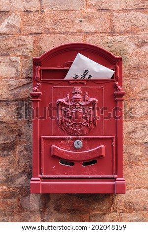 old mailbox on the wall - stock photo