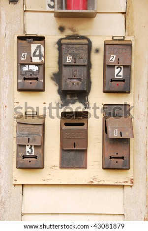 Old mailboxes on an apartment building in the 400 blk of SE Jackson, Roseburg OR - stock photo