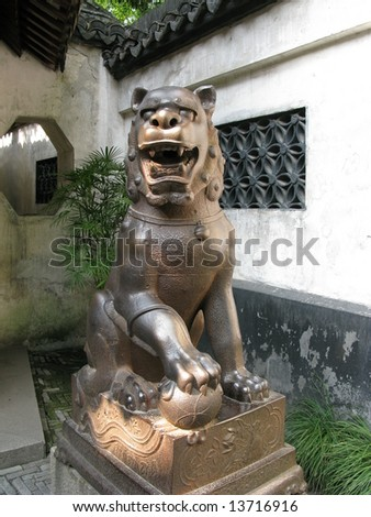 Old male iron lion statue in the Yuyuan garden, Shanghai