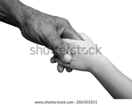 old man and a kid holding hands together on white background , black and white , B&W - stock photo