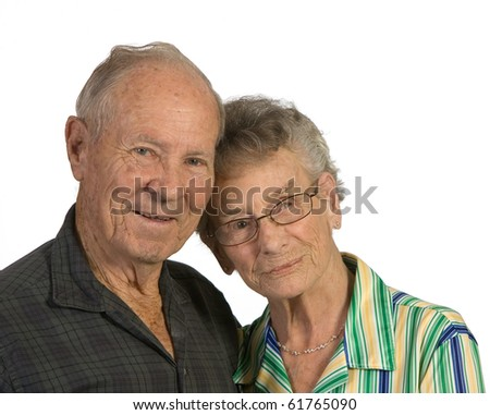Old man and woman close together. Shot against a white background. - stock photo