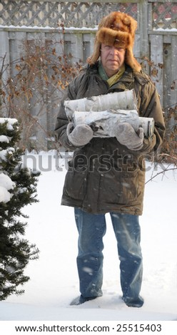 Old man carrying firewood