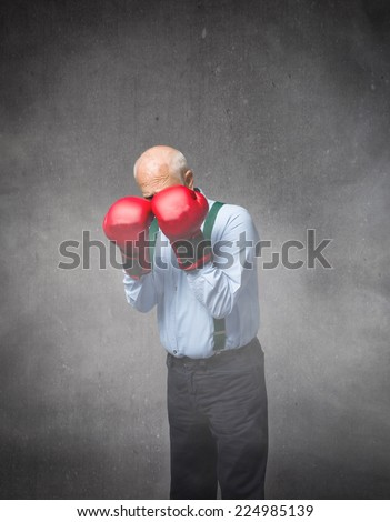 old man defending boxing position