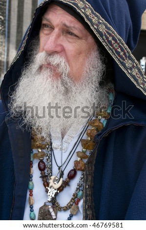 Old man, fortune teller and magician with long beard. - stock photo