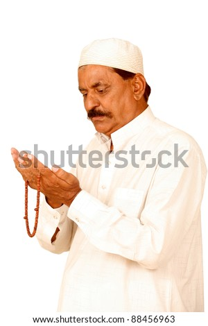 old man hands with muslim prayer beads